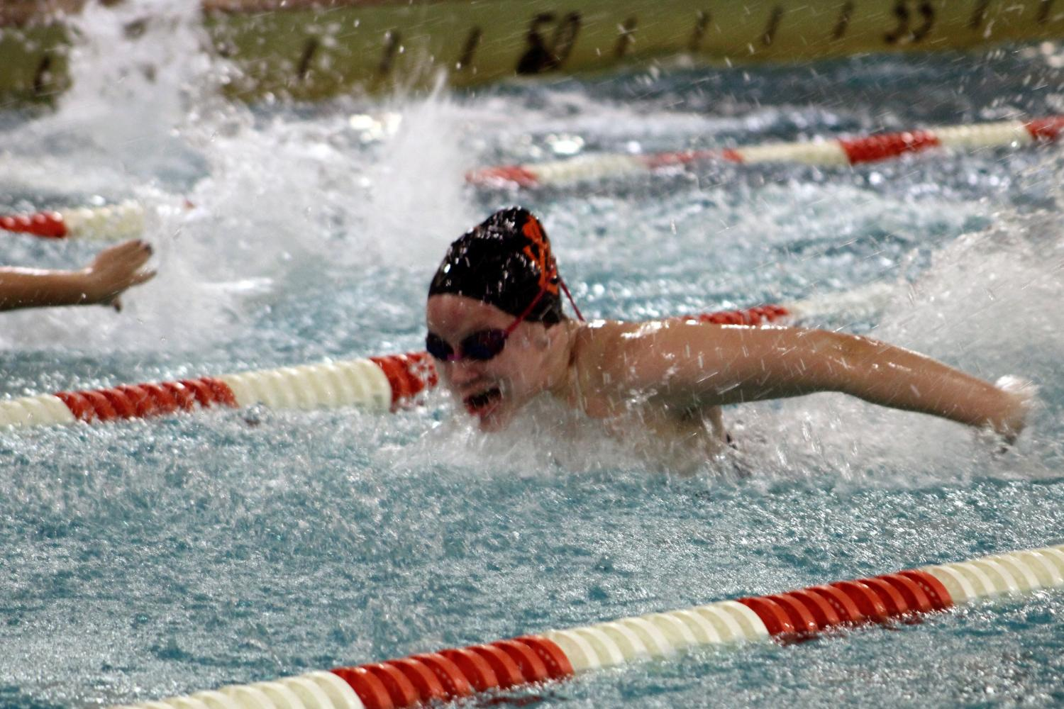 Sophomore Franny Bevel swims the 100m Butterfly. The team won against Bloomington Jefferson 51.5-42.5.