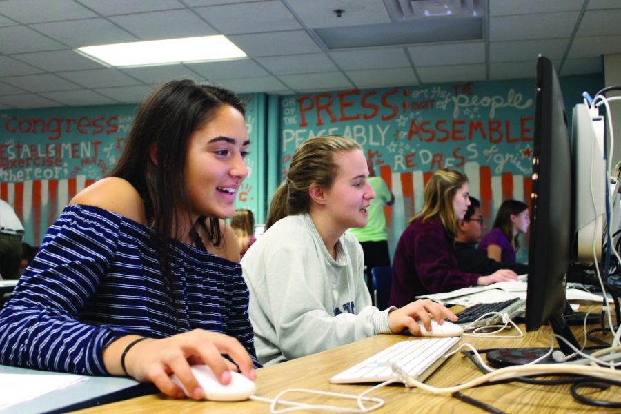 Echo staffers Hannah Leff and Raquel Fhima work on the latest cycle of the Echo Newspaper in the publications room. The next cycle of the Echo comes out October 25.