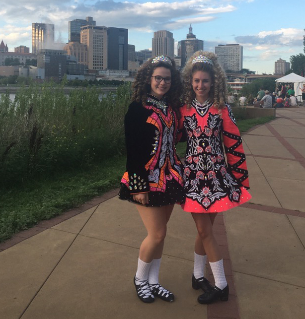 Sophomore Maggie Klaers poses with her teammate Melanie Smith after a long day of shows starting at 4 p.m. Aug. 13 on Harriet Island in St. Paul. This show at the Irish fair is one of many Maggie performs in around St. Patrick's Day.