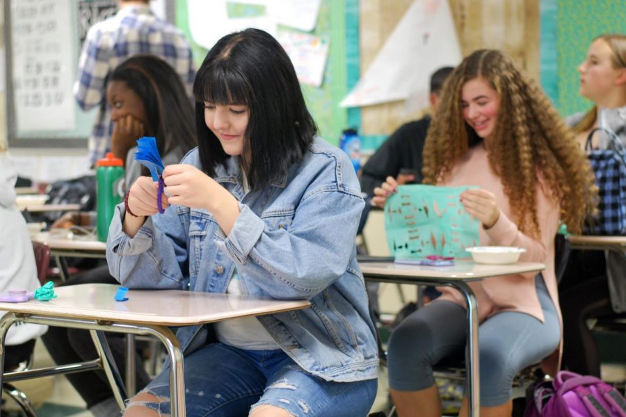 Spanish club members make paper decorations called 'Papel Picado' during the first meeting Oct. 25.