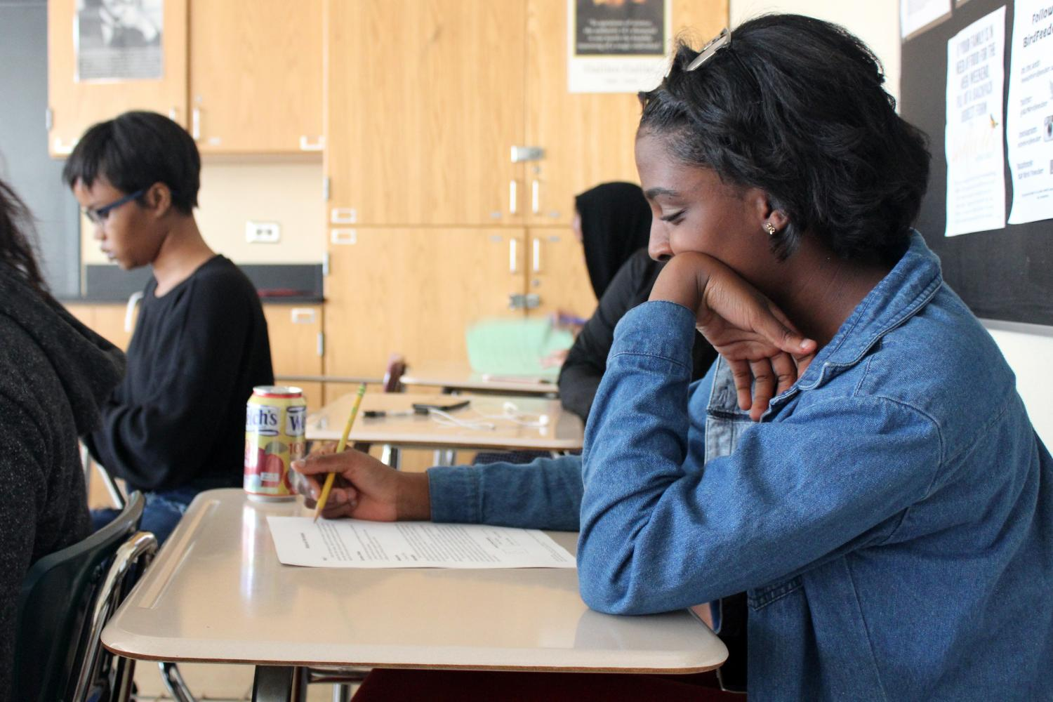 Junior Alaysha McCall-Davis completes a test in room A305. The PSAT takes place at 8:20 a.m. Oct. 11 in the old gym.