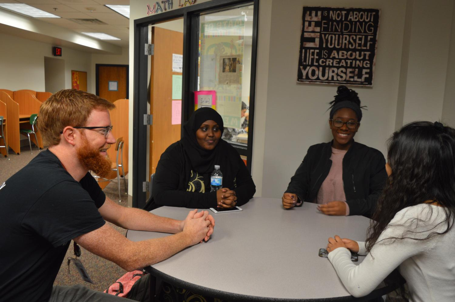 Equity coach and SOAR adviser Matthew Horel talks to seniors Rahma Farah and Ambriya Reese about the complexities of race. SOAR meets every Thursday at 8 AM.