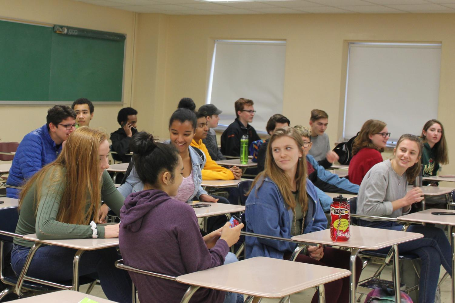 Students wait for AP U.S. history class to begin third hour Tues. Nov. 21. Third hour experienced an influx of students due to schedule changes.