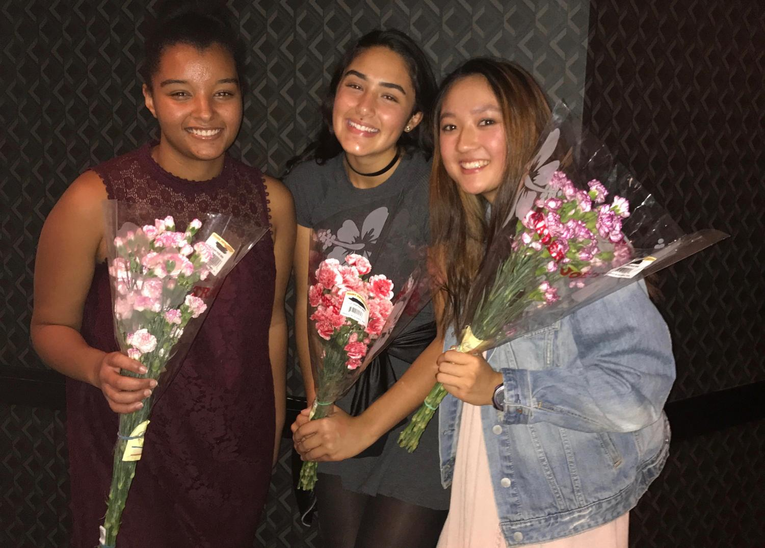 Junior Sidney Hosfield, sophomore Racquel Fhima and Junior Susi Hu at the tennis banquet Oct. 25. The three players received flowers after they were notified that they were chosen as captains for the 2018 season.