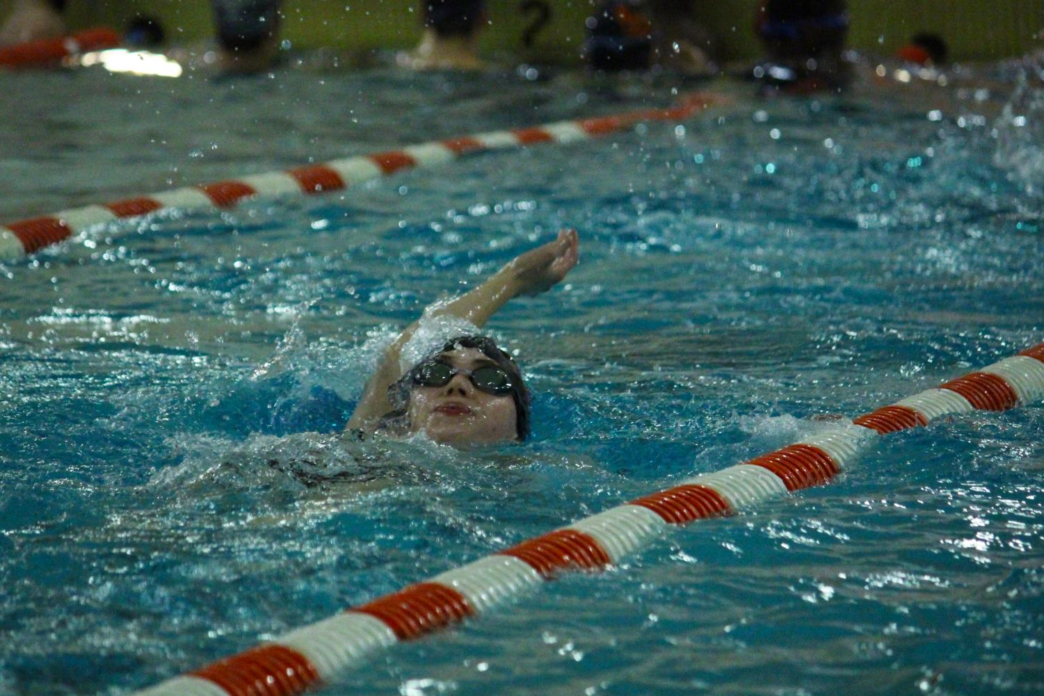 Senior Tommy Guddal practices the backstroke Nov. 28. The boys' swimming team is preparing for their first conference relay at Richfeild Middle School Dec. 7.