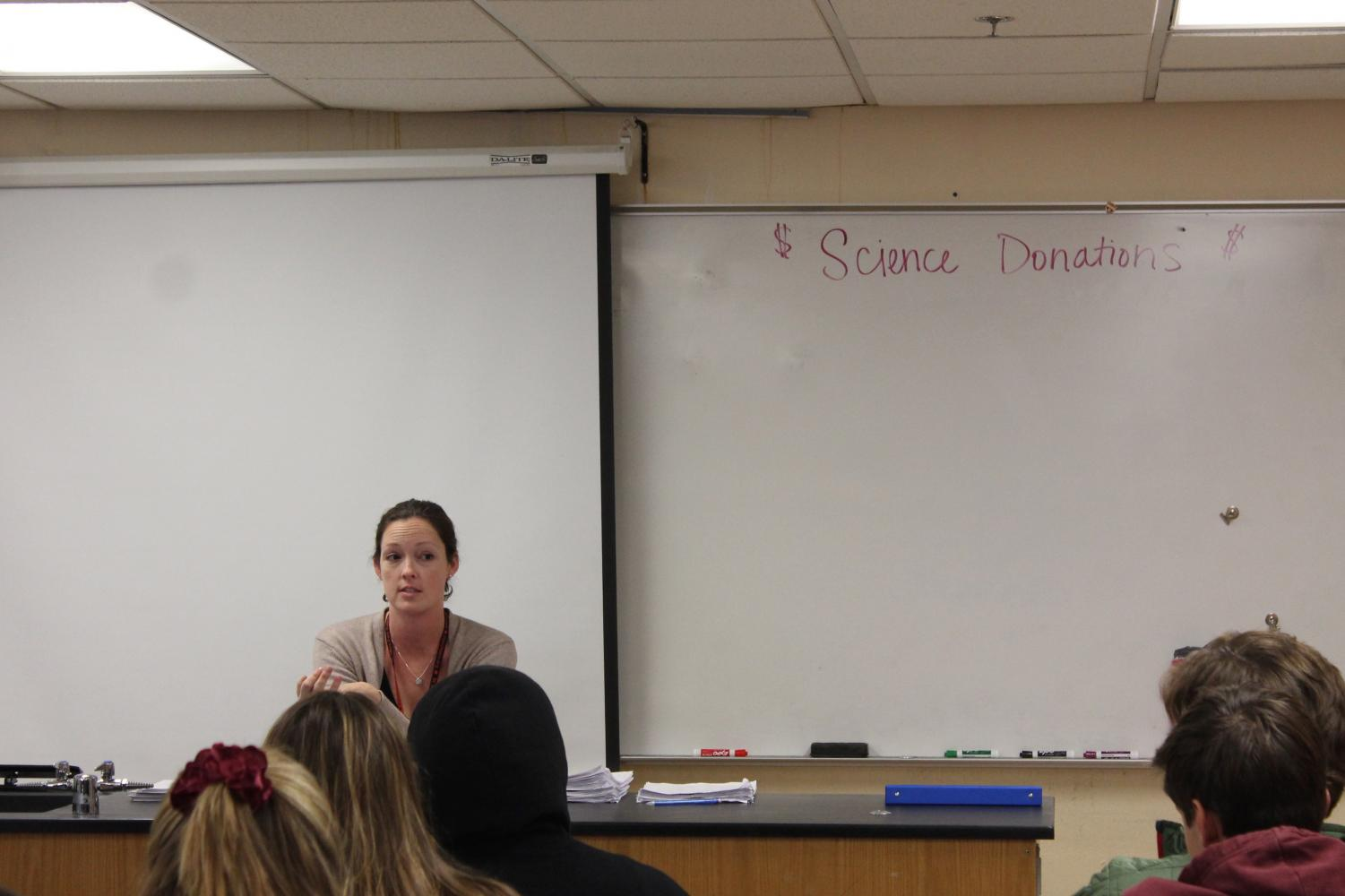 IB Biology teacher Julie Schilz teaches in a class on November 9. The science department accepts donations from students and their families to help fund the science program.