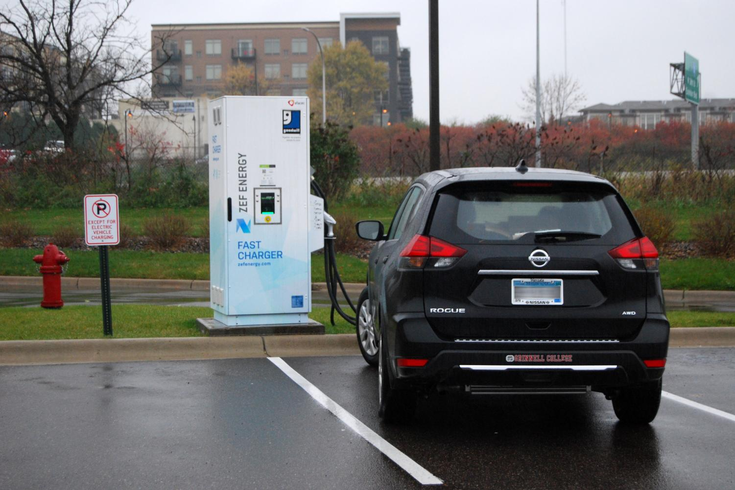 A car parks near the electric car charger at the Goodwill on Hwy 100. The City of Minneapolis is considering changing their official vehicles from gas to electricity powered.