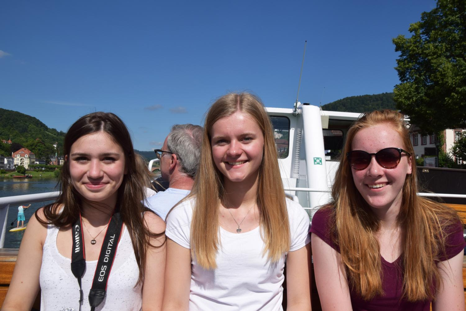 Junior Sara Anderson sits next to her host sister Paula and her friend Patricia as they take a boat tour through Heidelberg, Germany June, 10. Park students spent 3 weeks in Germany living with their host families and they will spend two weeks at Park this coming January.