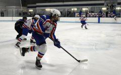 Girls' hockey defeats Rogers Royals