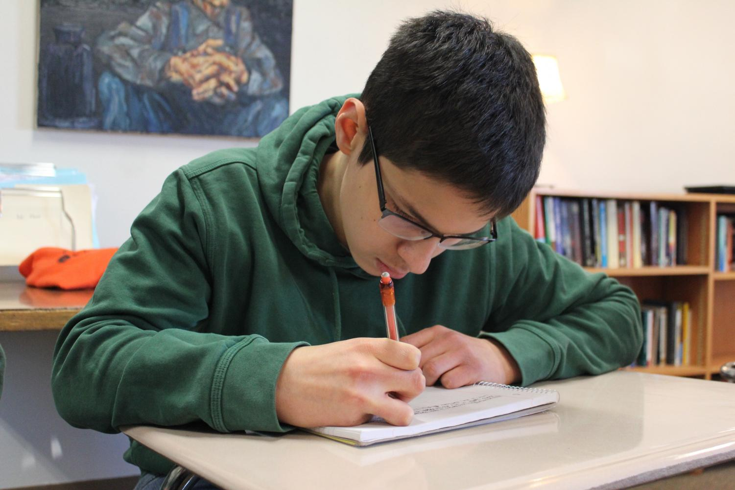 Junior Jack Ostrovsky works in class on November 9. Ostrovsky scored a 36 on his first ACT in September.