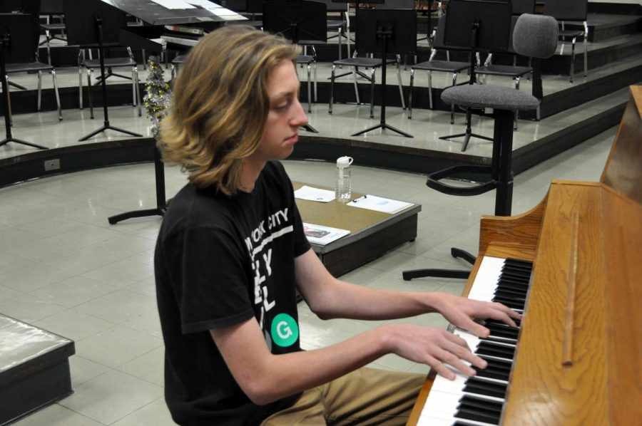 Junior Marco Giovanelli plays the piano, his primary instrument, in the band room after school on Nov. 1.