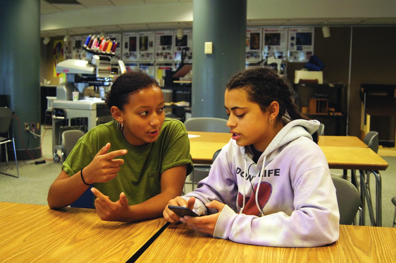 Seniors Malaika Bigirindavyi and Anna duSaire discuss future plans for their Instagram account, tagged @mixtaslp. Seniors Rosa Sigrúnardóttir and Olivia Massie, not pictured, also run this account.