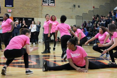 Sophmore Parkette Kypri Cepeda-Johnson does the splits while performing for the first time at the pep fest. The Parkettes have acquired new members and recently designed new apparel.