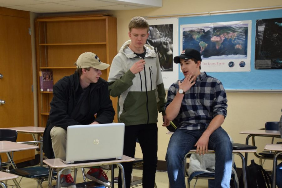 Socio-Political Club co-presidents  seniors Eli Curran-Moore, Ryan Lee and member Adam Recknagel discuss various topics in room C357 after school. The next club meeting is Dec. 6.
