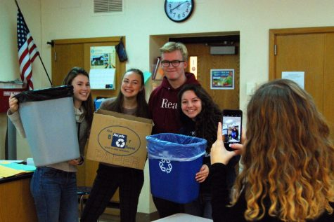 Recycling committee members, all juniors, Anika Hansen, Emma Kempf, Casey Kreie, and Leila Raymond pose for a Roots and Shoots photo at the meeting on  Nov. 7.