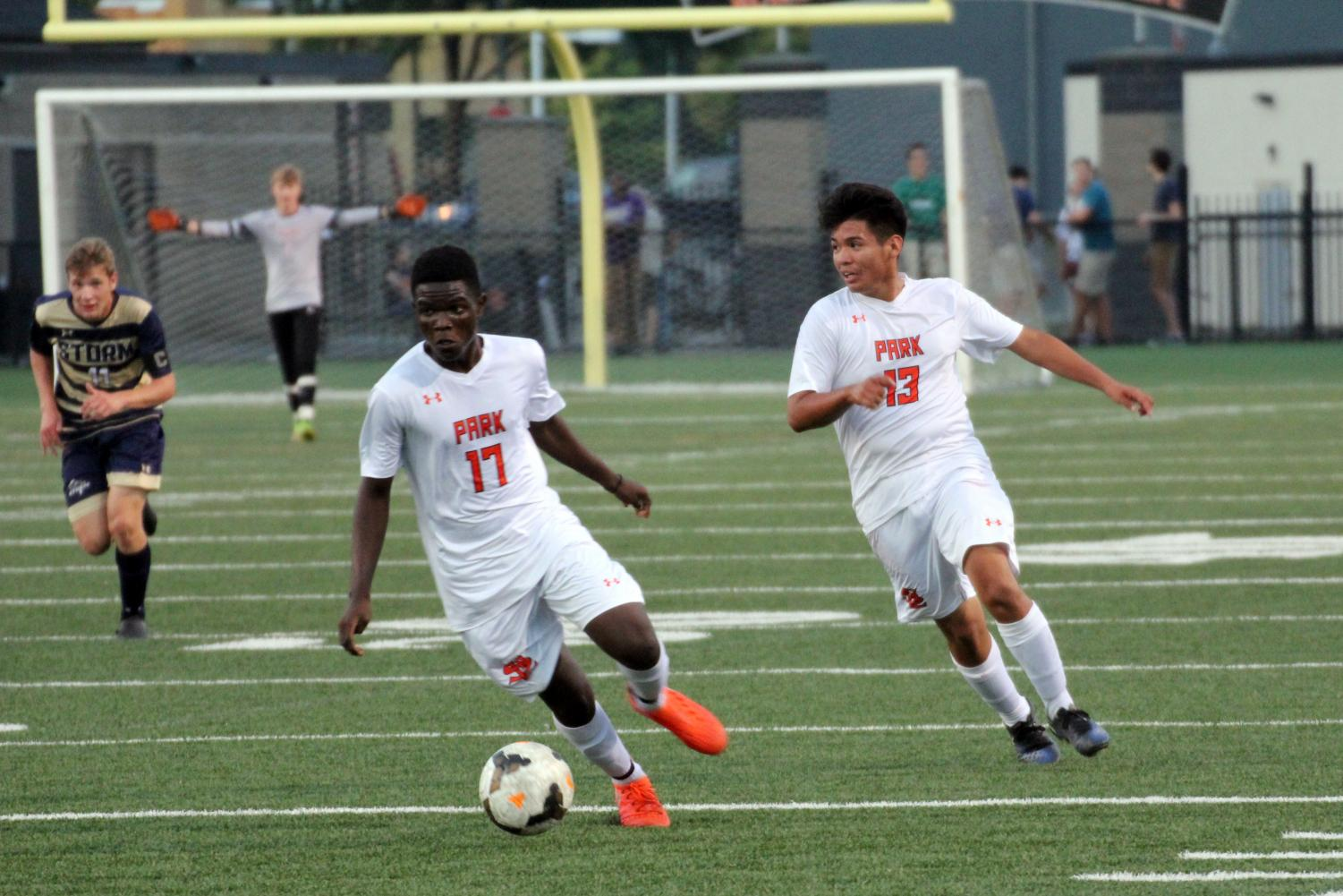 Seniors Randy Mayele and Antonio Olivas-Reyes work to get the ball away from their side of the field. Park soccer played Chanhassen Sept. 14.