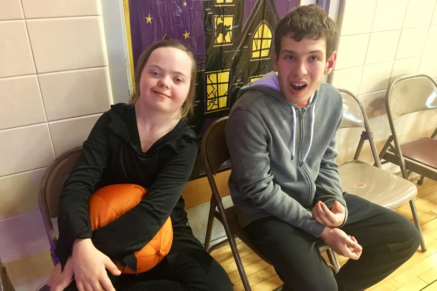 Sophomores Monica Smigleski and Edan Cherrill partake in the Halloween festivities at a dance hosted by Transition Plus Oct. 27. Transition Plus hosts two dances a year for the Special Education programs in the districts it serves.