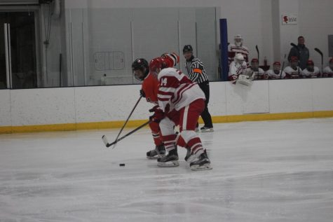 Senior Jonny Sorenson forward attempts to steal the puck from Benilde-St. Margret defense player Nate Schweitzer Dec. 22. at the Rec Center.
