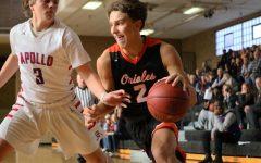 Boys' basketball takes first win of season
