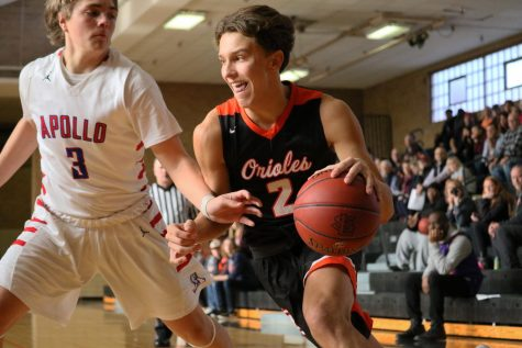 Boys' basketball takes first win of season