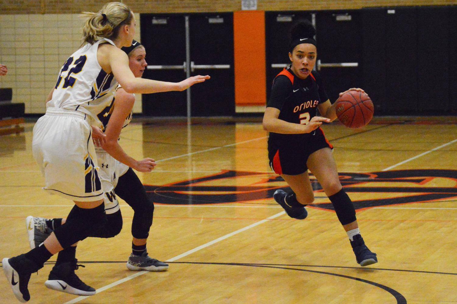 Freshman Joelle Sheffield dribbles down the court in the Orioles game against Waconia Dec. 5. The next girl's basketball game is at 6 p.m. Dec. 8 at Fridley High School.
