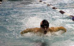Boys' swimming races through first Conference Relay