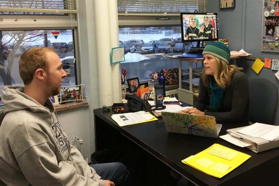 In this photo illustration, senior Ian Mcintyre discusses plans over break with ninth grade counselor Barb Nelson. Nelson often meets with students before a long break to check in and support them.
