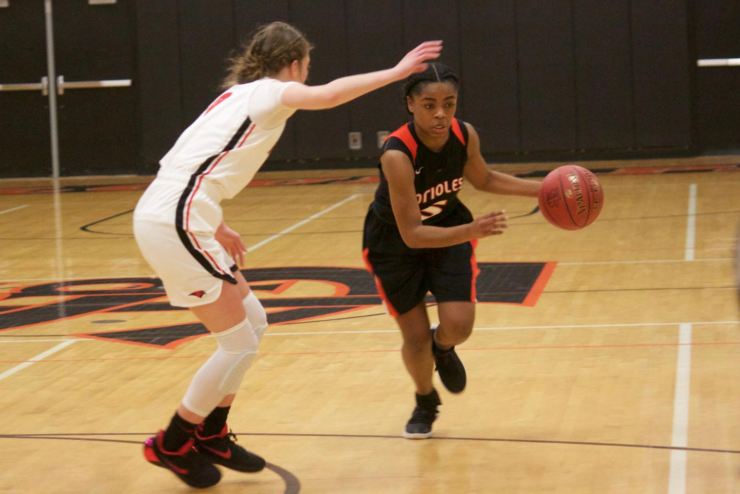 Senior captain Kamil Mayfield drives to the basket against Minnehaha Academy on Dec. 15. The Orioles lost 56-68.