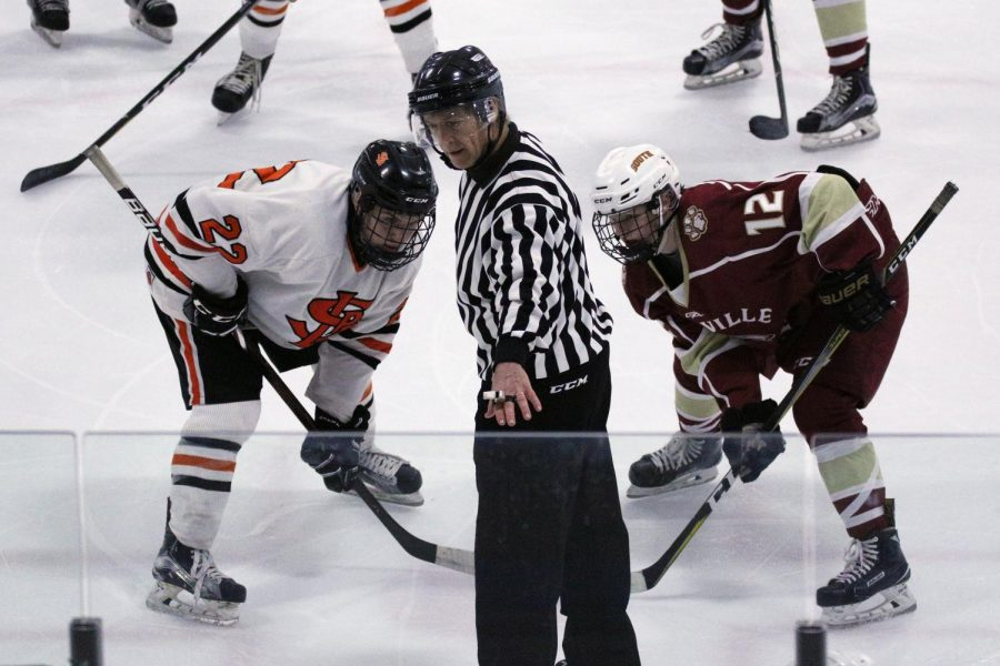 Senior Willy Basil lines up for a faceoff against a Lakeville South center. Park beat South 2-1 in overtime Dec. 14.