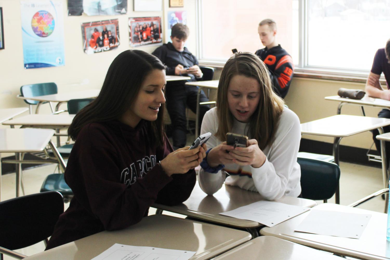 Juniors Lily Kulevsky and Claudia Stone take the Student Engagement Survey during their math class on Dec. 18. The Student Engagement Survey helps teachers learn how to improve different areas in the classroom.