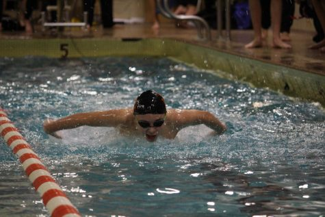 Boys' swimming falls to Hopkins in first dual meet