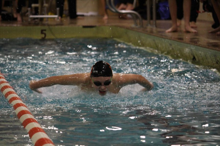 Freshman Andre Barajas swims the butterfly during the meet against Hopkins Dec. 14. The boys' swimming team's next meet is away against Watertown-Mayer Dec. 19.