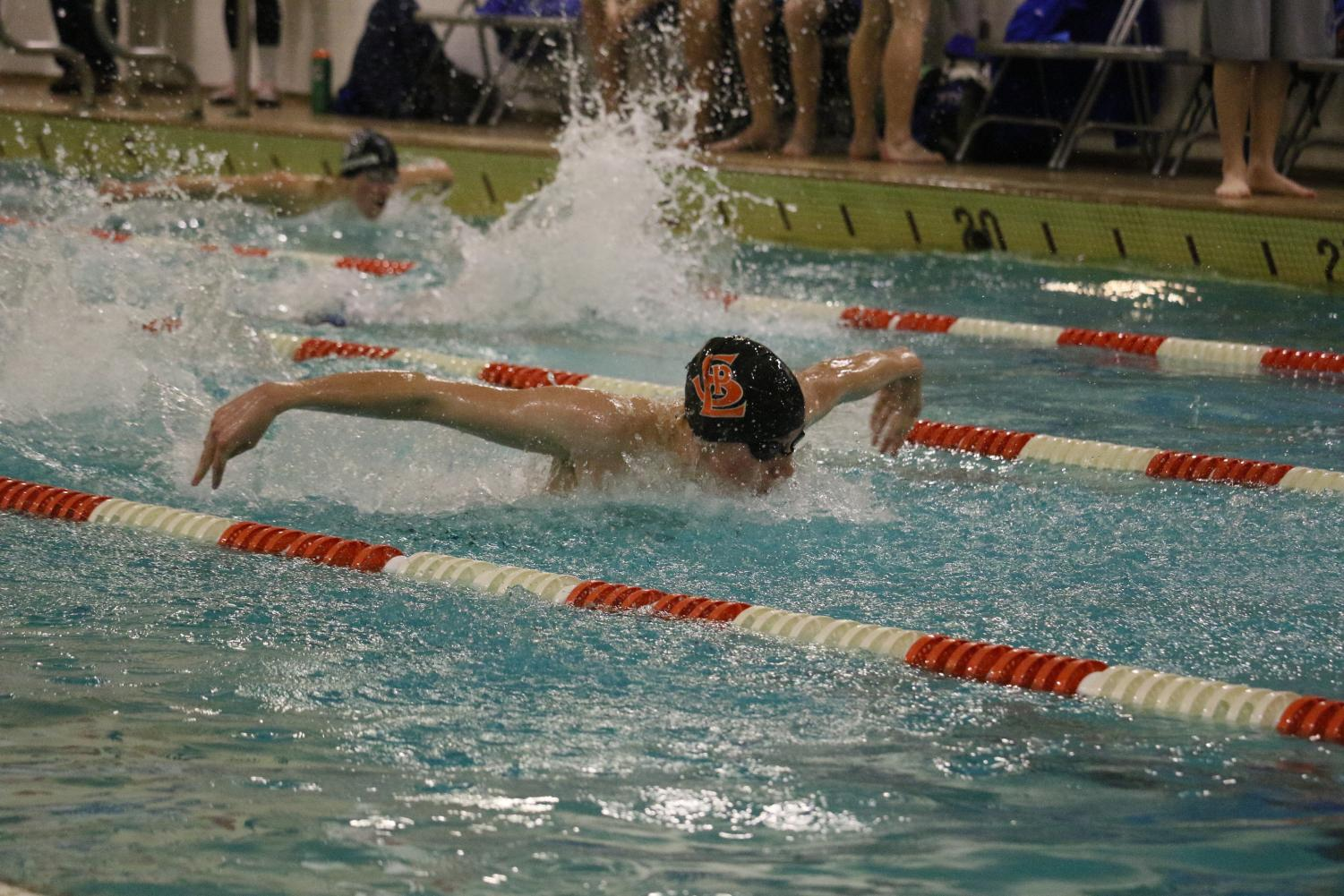 Senior Luke Anderson competes in butterfly during a meet against Bloomington Jefferson. Anderson recently committed to continue swimming at the University of St. Thomas next year.