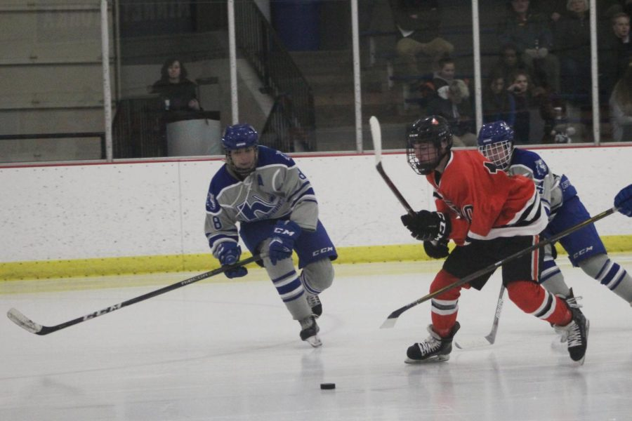 Freshman Jack Wandmacher looks to play the puck during the Orioles win against Hopkins. Park won 5-0, shutting out the Hopkins offense.