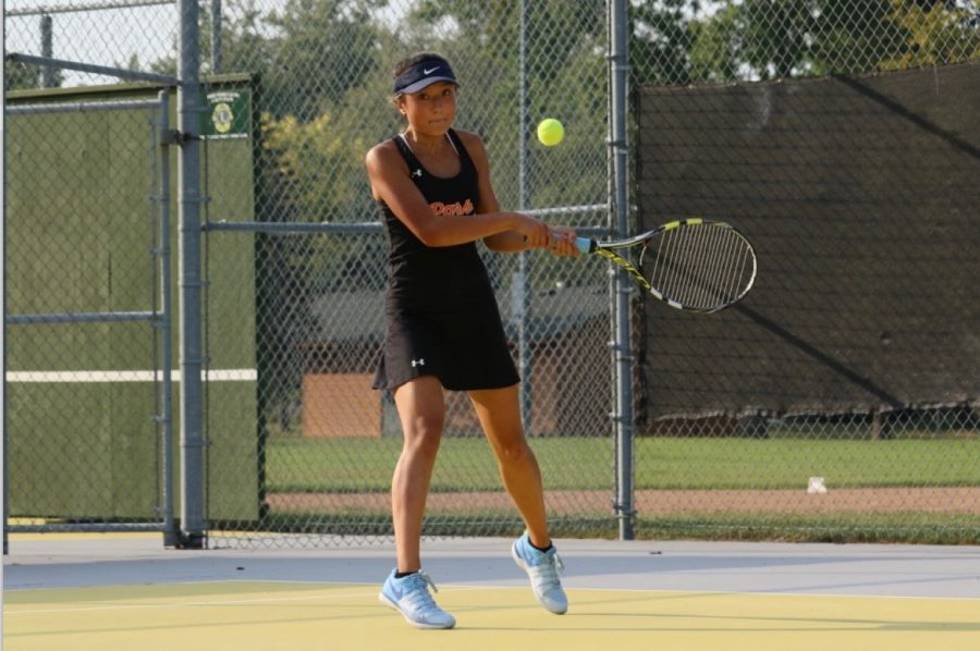 Junior+Susanna+Hu+works+her+backhand+during+one+of+her+matches+during+the+tennis+season.+Hu+has+directed+much+more+of+her+free+time+towards+tennis+instead+of+other+activities.