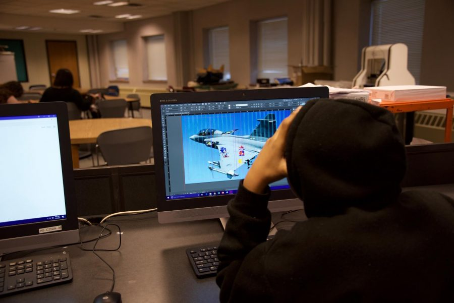 Freshmen Anton Lyme works on his final project for Graphic Design on Jan. 16. Media Arts is one of several art tech classes Paulson teaches.