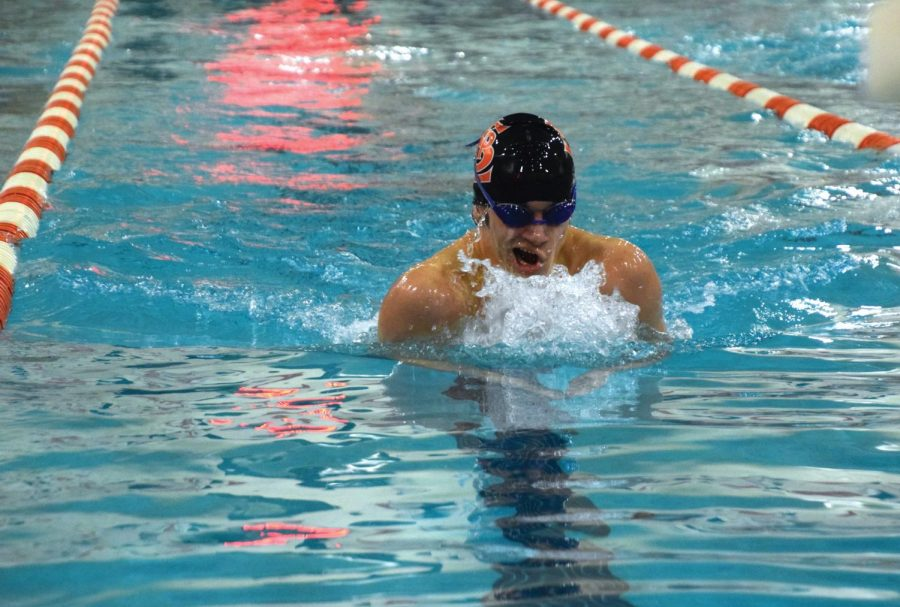 Senior captain David Salamzadeh swims the 200 individual medley Jan. 16.   Salamzadeh finished with a time of 2.07.