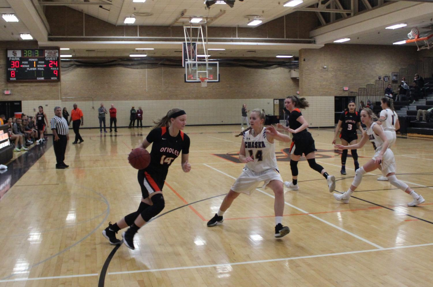 Junior Lindsey Olson dribbles past a Chaska defensive player. The Orioles won 74-61 on Jan. 16.