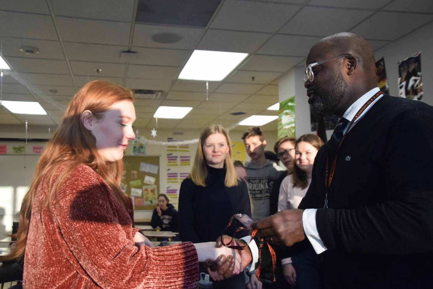 Superintendent Astein Osei greets the incoming German exchange students Jan. 29.
