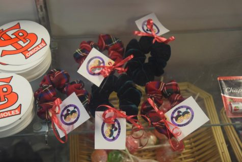 Mama's Scrunchies sit in the display case inside the Storiole. They are sold for $3 each.