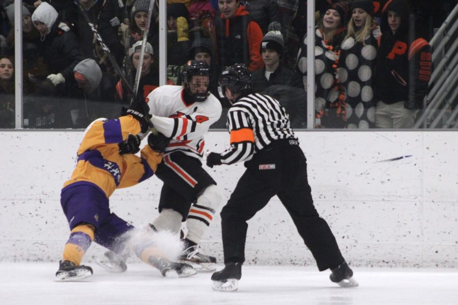 Senior and Captain Jonathan Sorenson fights for the puck against a Chaska forward in its outdoor game Jan. 30 at the ROC against Chaska. Park  lost in overtime with a final score of 6-5.