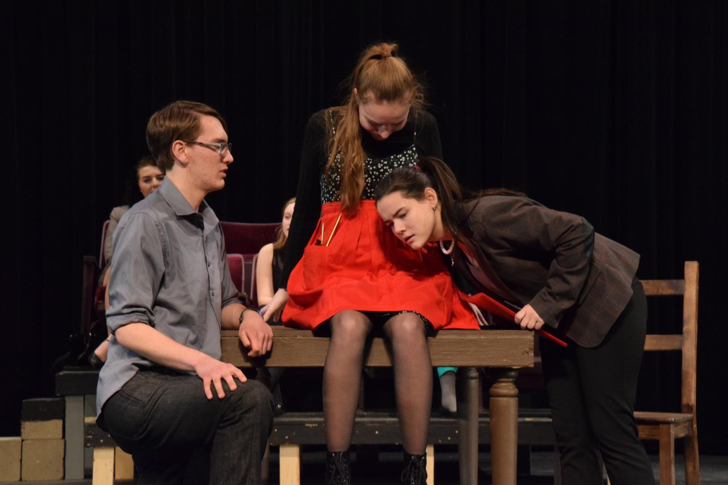 Senior Thomas Bryant and juniors Emma Kempf and Morganna Oberdorfer act in the winter one-acts in January. The upcoming spring play will be pushed back to April 27-29 due to conflicts with Prom.