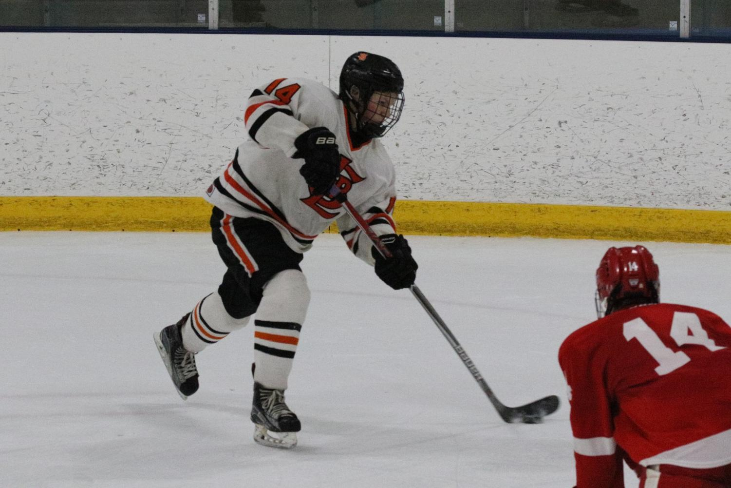 Sophomore Avery Pittman takes a wrist shot in his game against Benilde