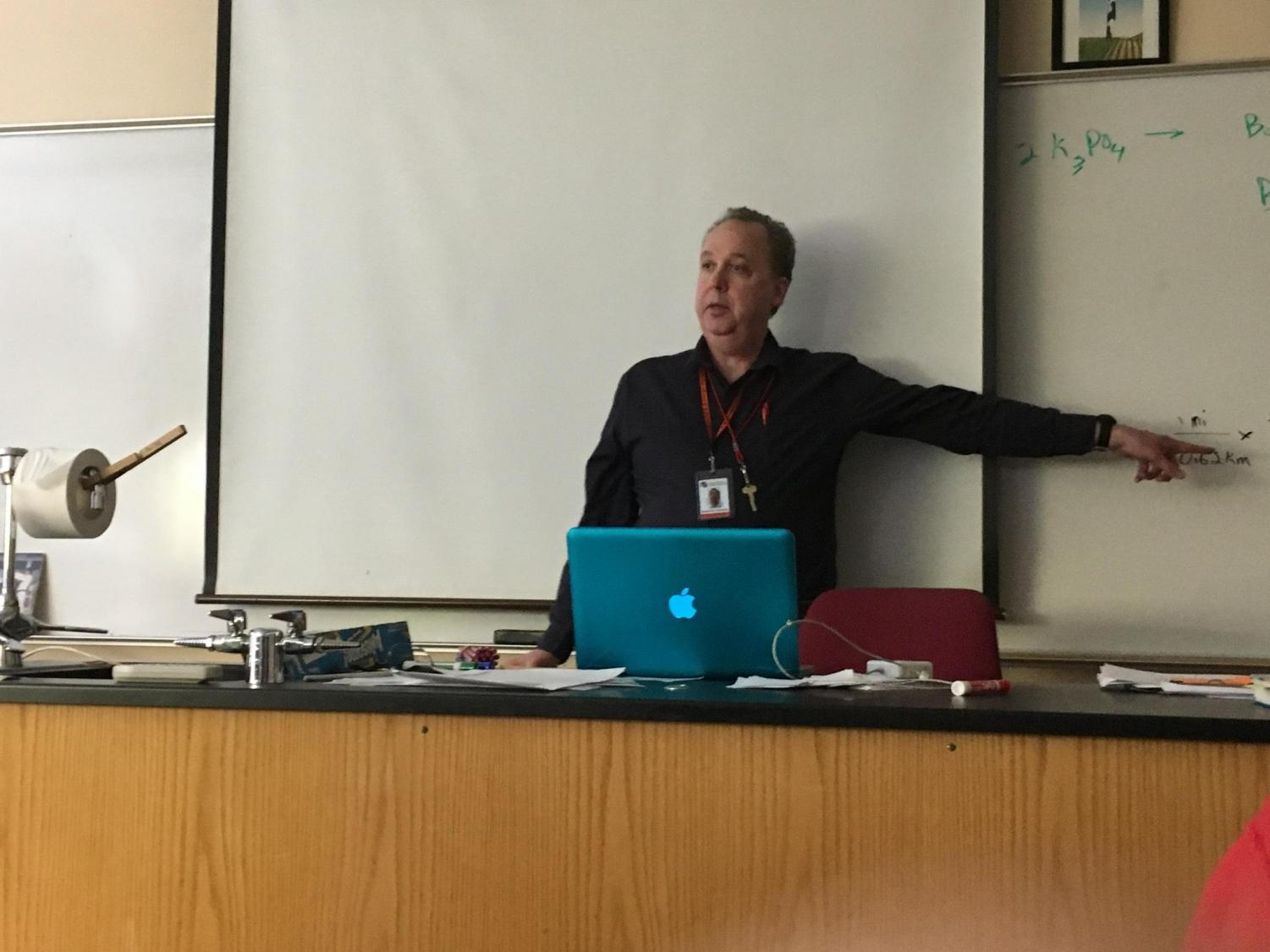 Chemistry teacher Patrick Puskala uses his Macbook Pro to teach class Feb. 2.