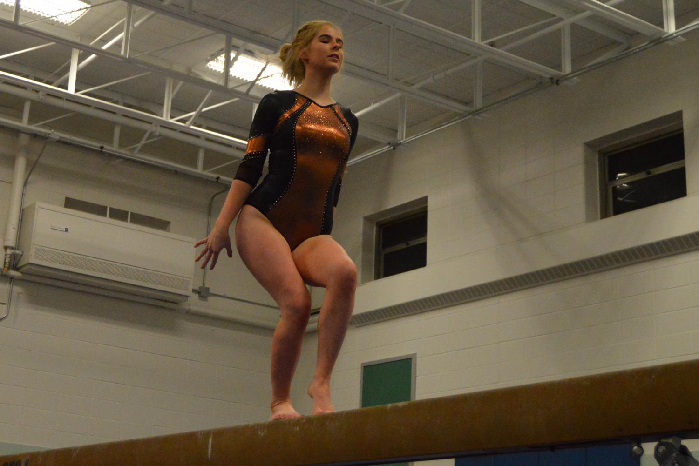 Senior+Annika+Eldridge+performs+her+beam+routine+at+Park%27s+gymnastics+senior+night.+Park+lost+to+Breck+129-132