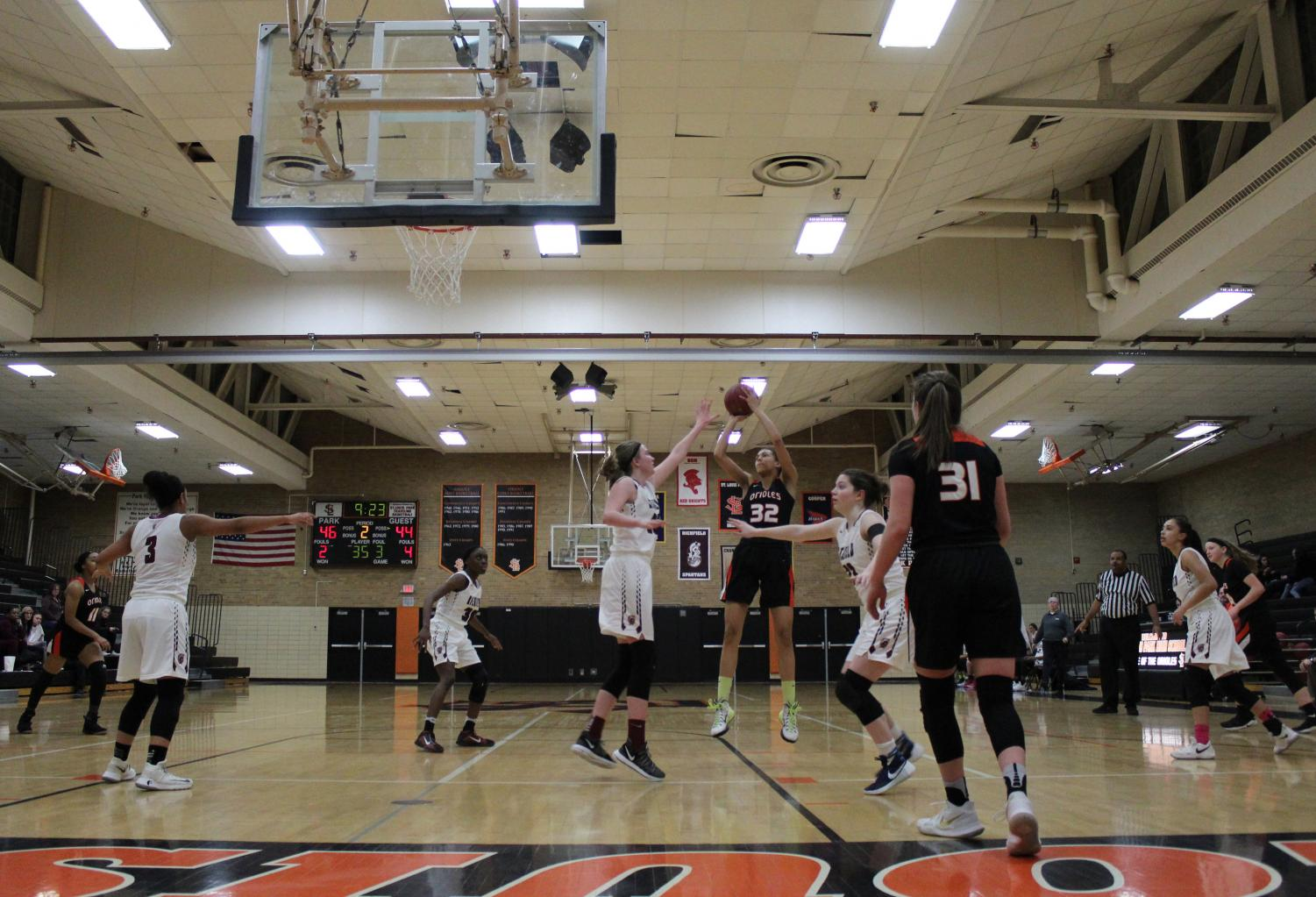 Freshmen Kendall Coley shoots over defender from Chaska during the game on Feb. 15. The Orioles win 71-61.
