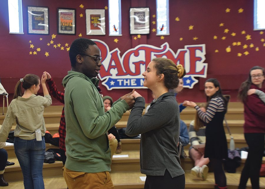 Seniors+Ndunzi+Kunsunga+and+Eva+Arago+rehearse+their+roles+as+Prince+Charming+and+Cinderella+for+the+upcoming+choir+musical+%22Cinderella%22+Feb.+11.+The+show+opens+March+1+and+will+run+through+March+3.