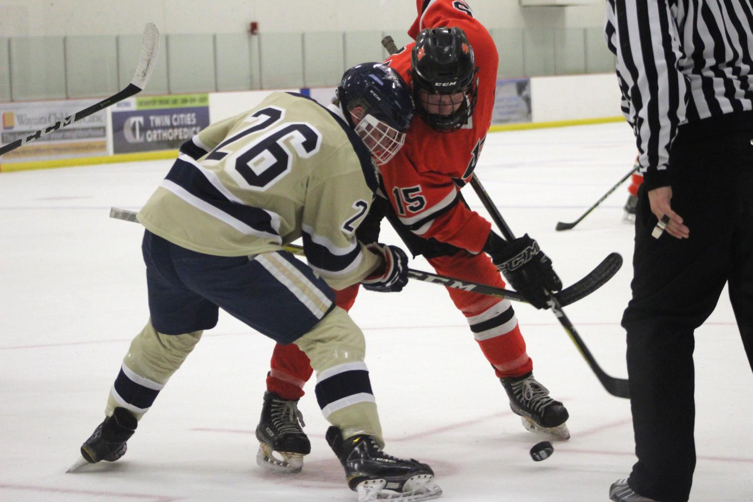 Senior Luke Mobley faces off against Chanhassen player Charlie Montag. Park beat Chanhassen 3-1 Feb. 8 at Victoria Field House.
