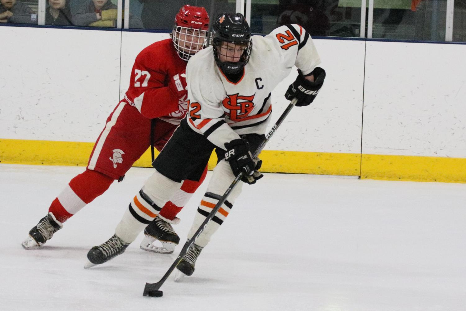 Senior+captain+Shae+Pekarek+carries+the+puck+down+the+ice+in+Parks+4-0+loss+to+Benilde+Feb.+13.+Park+went+scoreless+with+a+goal+being+called+off+in+the+second+period.