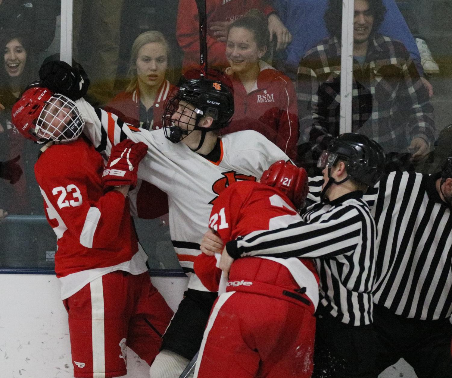 Senior+Connor+Johnson+pushes+Benilde%27s+Brady+Giertsen+while+Benilde%27s+James+Norkosky+is+being+restrained+by+a+referee.+A+fight+broke+out+near+the+end+of+the+game+after+a+late+hit+to+the+head+from+a+Park+player.+